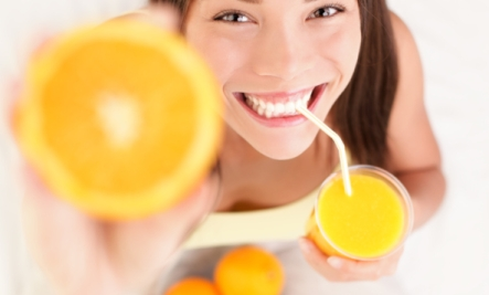 girl drinking orange benefits