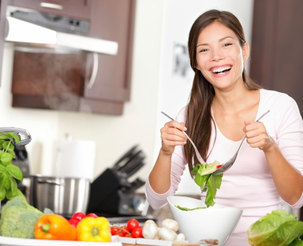 happy woman making salad