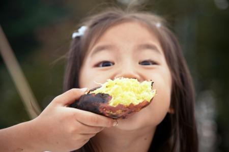 girl eating potato