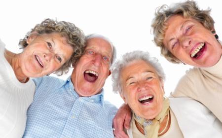 4 elderly laughing