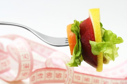 fork and fruit with measuring tape