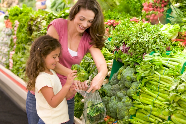 Mother and daughter avoid fattening foods and instead choose vegetables