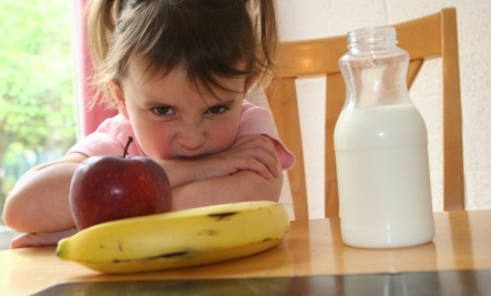 child lloking at potassium unhappy