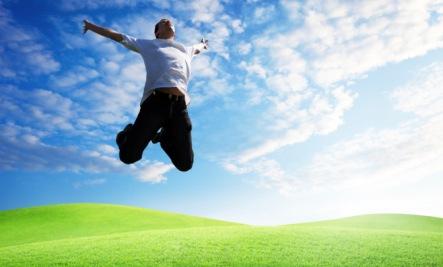 man jumping in air sunrise