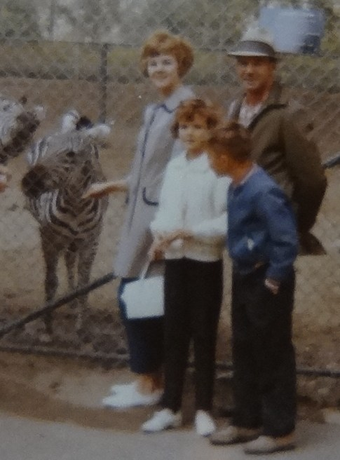Randy with two sisters and father at the zoo